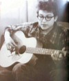1962 with acoustic guitar
